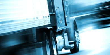 A semi-truck moving with a blurred effect.
