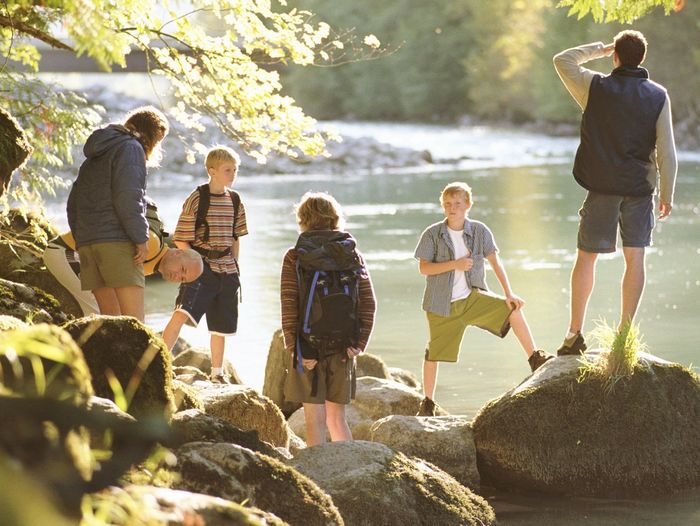Family with boys, in nature, spending time together.