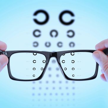 Eye glasses focusing on an eye chart