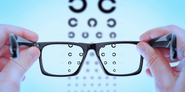 Eyeglasses looking at optometrist eye chart