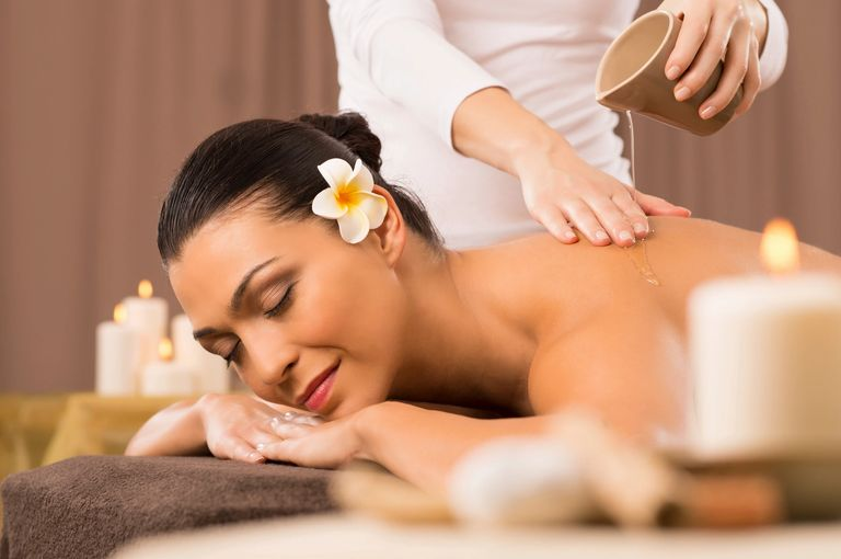 Women Beauty in salon, getting massage and body treatment.