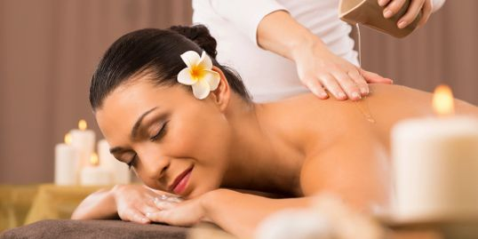 Alt = woman relaxed and being massaged, woman relaxing with spa treatment