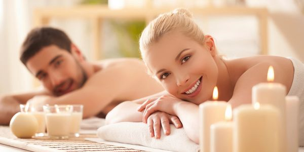 Man and woman receiving the benefits of a CBD oil massage in our private spa room in Pittsburgh, PA