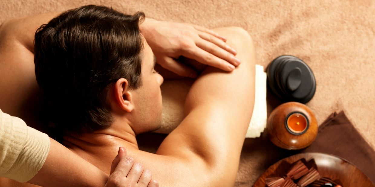 Man enjoying a deep tissue therapeutic massage at Nirvana Asian Massage near me Tacoma