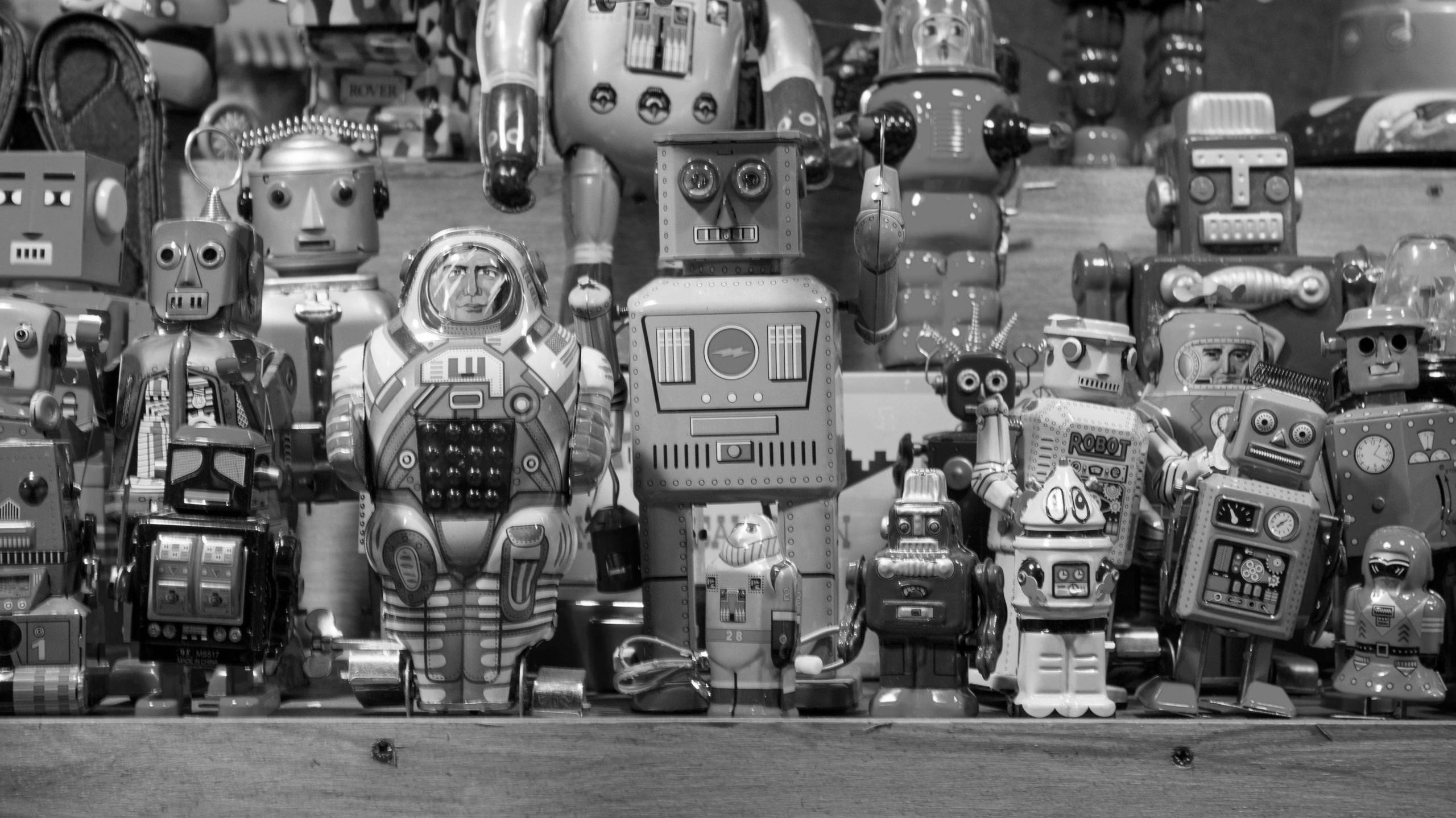 photo of many different shapes and sizes of toy robots