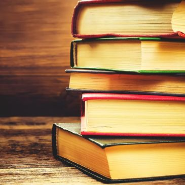 Stack of books with wood background