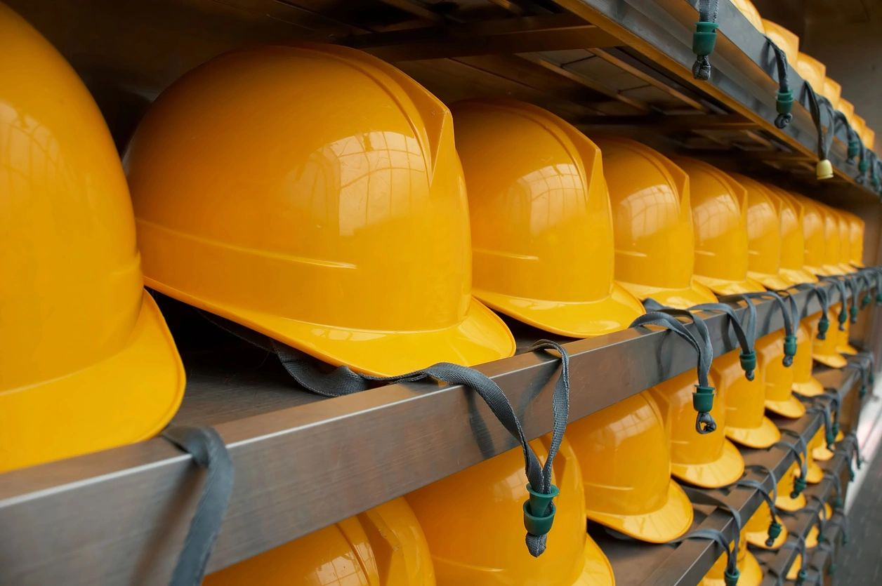 Yellow hard hats in a row.