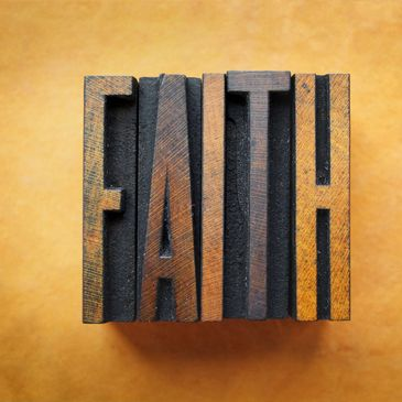 "A woodblock of the word ""Faith"""