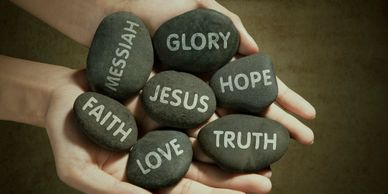 Rocks with Jesus, hope, love, faith truth printed on them