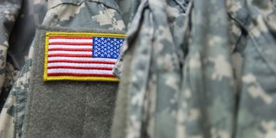 Military uniform with an American flag.