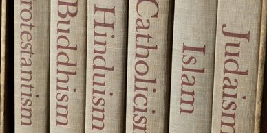 Book spines with titles of different religions to depict the religious abuse