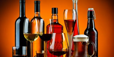 Liquor and wine bottles and various types of wine and snifter glasses for liquor liability insurance