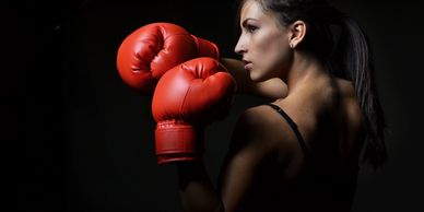 Self Love Diva coach profile of woman with red boxing gloves
