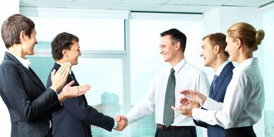 Sales people shaking hands with clients.