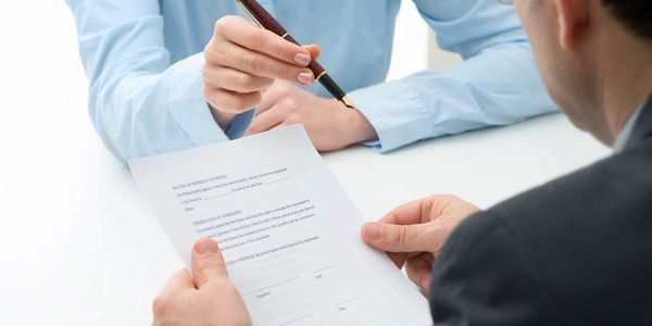 Business person signing paperwork