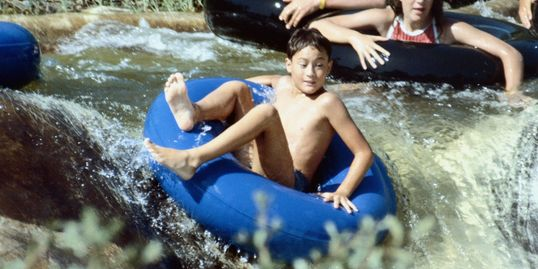 Tubing down 'Big Boulder Sluice' on Coffee Creek