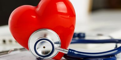 Health Insurance image of a red heart and a stethoscope