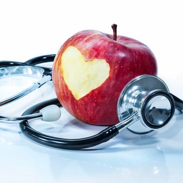 Stethoscope and an apple with a heart shaped bite