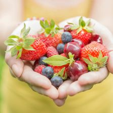 hands in heart with healthy food