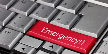 An emergency button on a keyboard showing we can go help immediately for hitting something beneith.