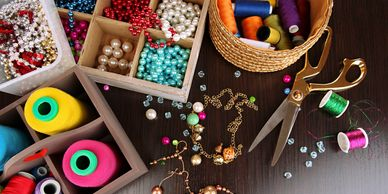 handmade jewellery, jewelry, seedbeads, chains, ropes, necklaces, earrings, beads with scissors and chain on a table