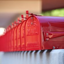 Red mailboxes all in a row.