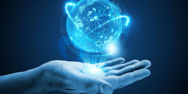 Hand holding a glowing globe implying learning the latest technologies, and learning to code, is the key to the future.