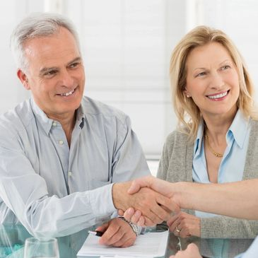 Senior Couple Shaking Hands with Insurance Agent After Choosing Medicare Supplemental Insurance