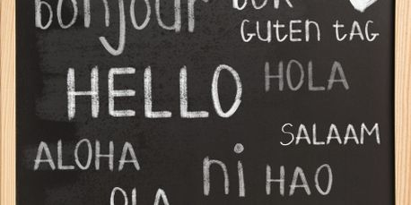 Hello in many languages on a chalkboard.