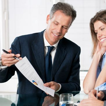 Direct Sales Co Credit Card Services. Guy presenting paperwork to woman. MLM credit card processing