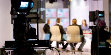 Film crew producing a corporate roundtable.