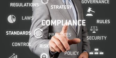 image of a man pointing to the word compliance