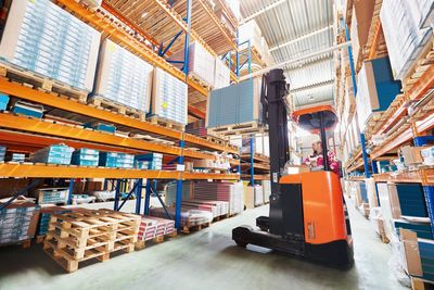 Reach truck operating in racking