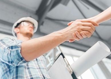 Contractor shaking hands building and planning construction, contractor shaking hands with client.