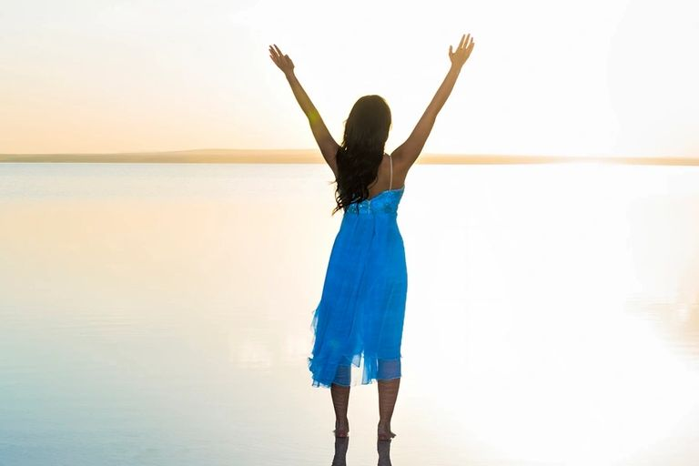 Success image - woman with arms raised