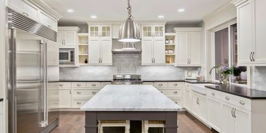 kitchen remodel, marble, stainless steel, modern, white cabinets, kitchen island, lighting