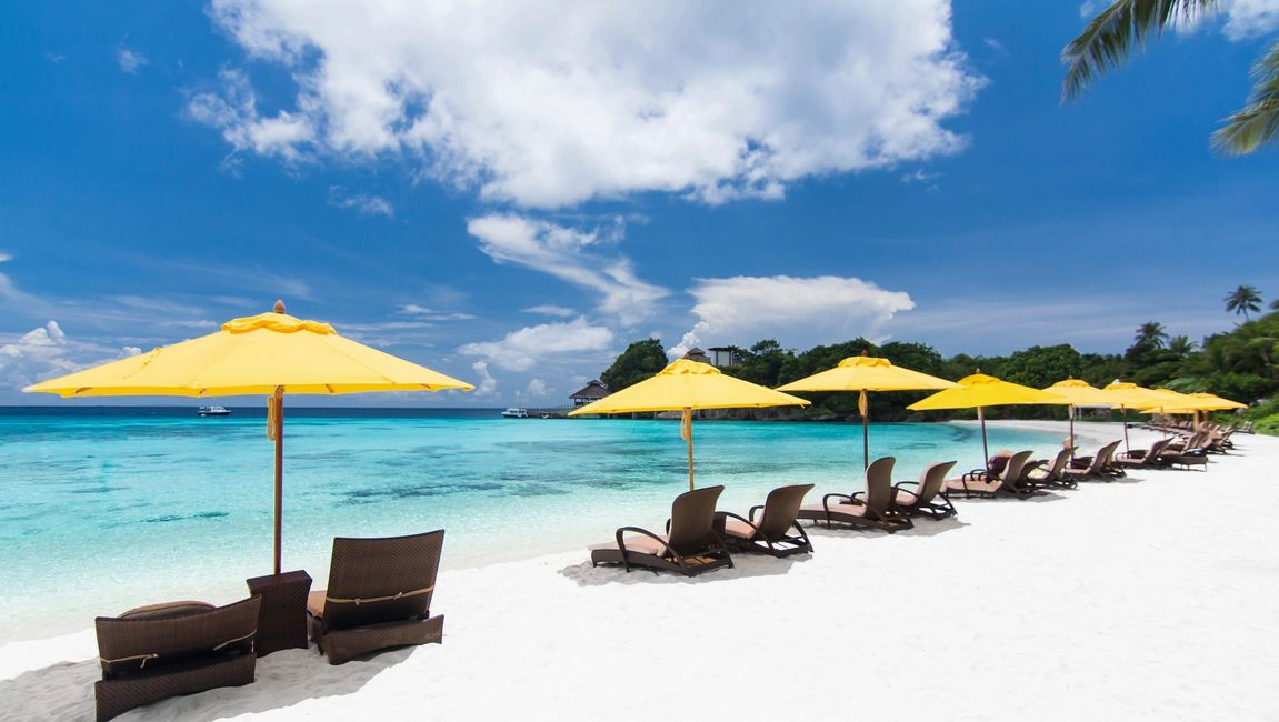 White sandy beach with chairs