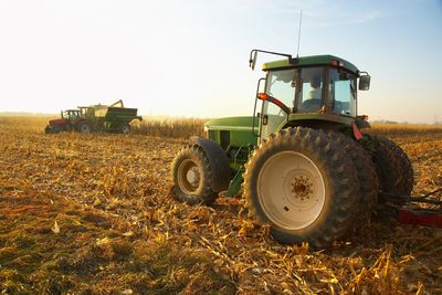 Tractors working in a field representing the agricultural industry
