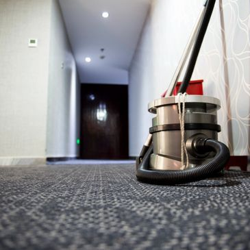 Carpet equipment demonstrating cleaning of commercial building