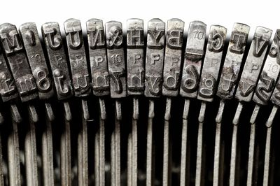 Old-fashioned typewriter key hammers