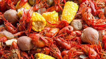 Crayfish, also known as crawfish, boiled in creole seasoning with corn and potatoes.