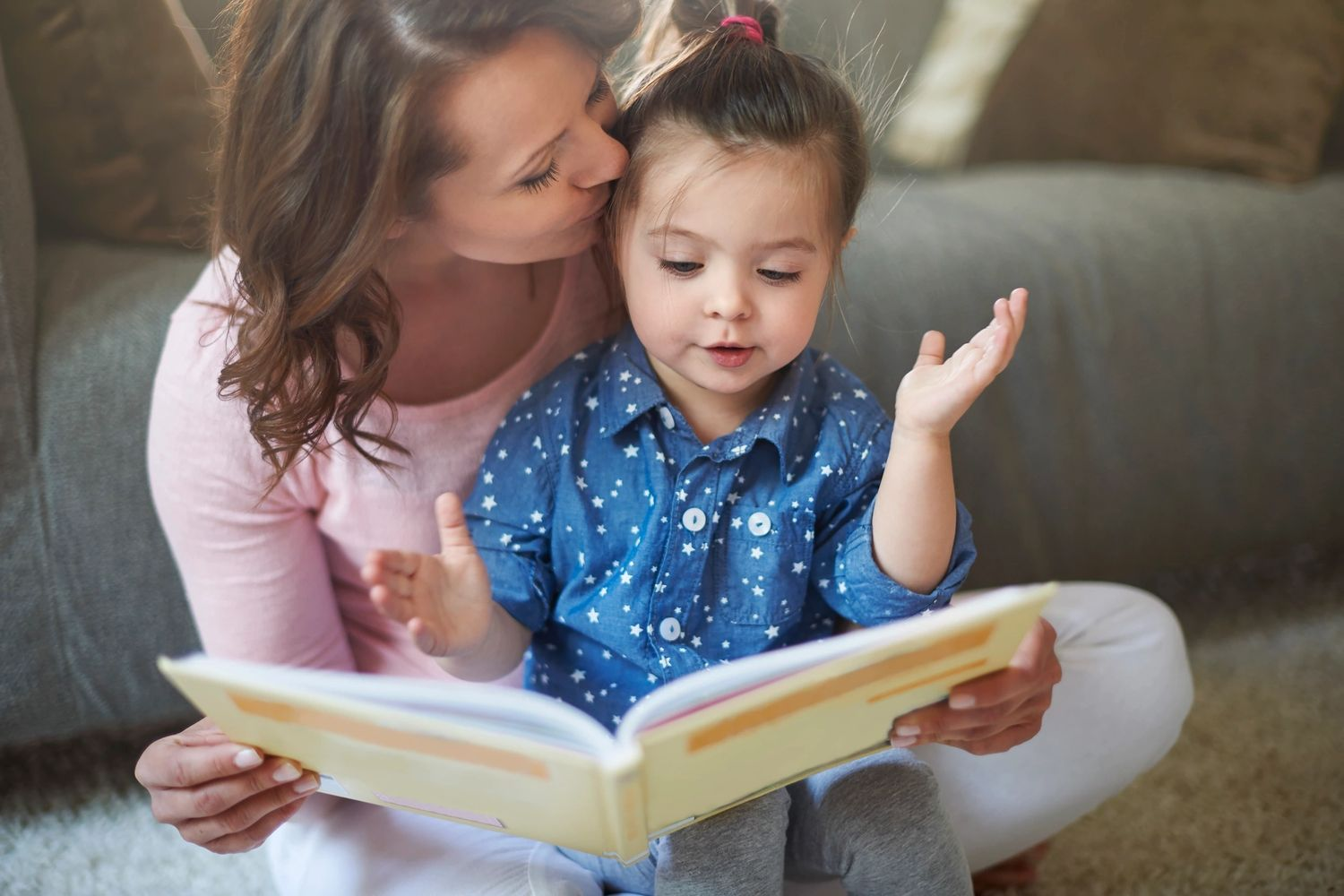 Mother reading to child in a safe environment.