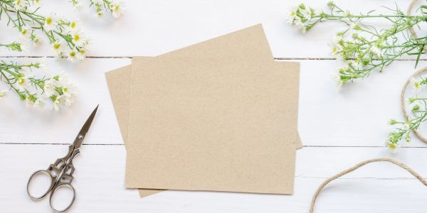 blank paper with a pair of decorative scissors