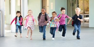 children, running, backpacks, finished school, the day is over, having fun, smiling, laughing,