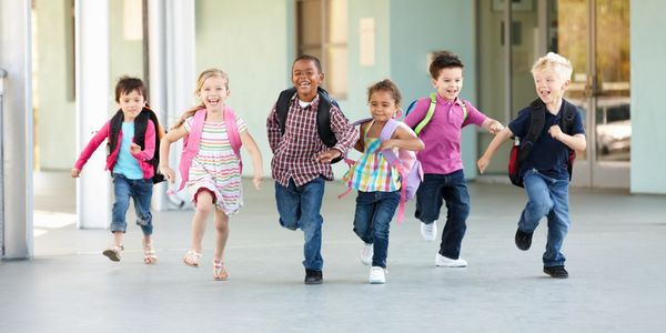 Children running at school in the hallways