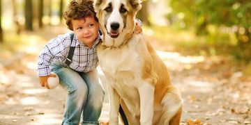 Precious photo of child and dog