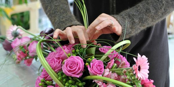 florist making funeral tribute flowers