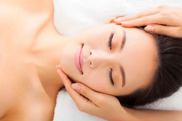 Young woman relaxing during facial treatment
