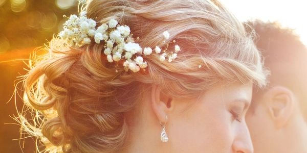 Curled and styled wedding hair with flowers