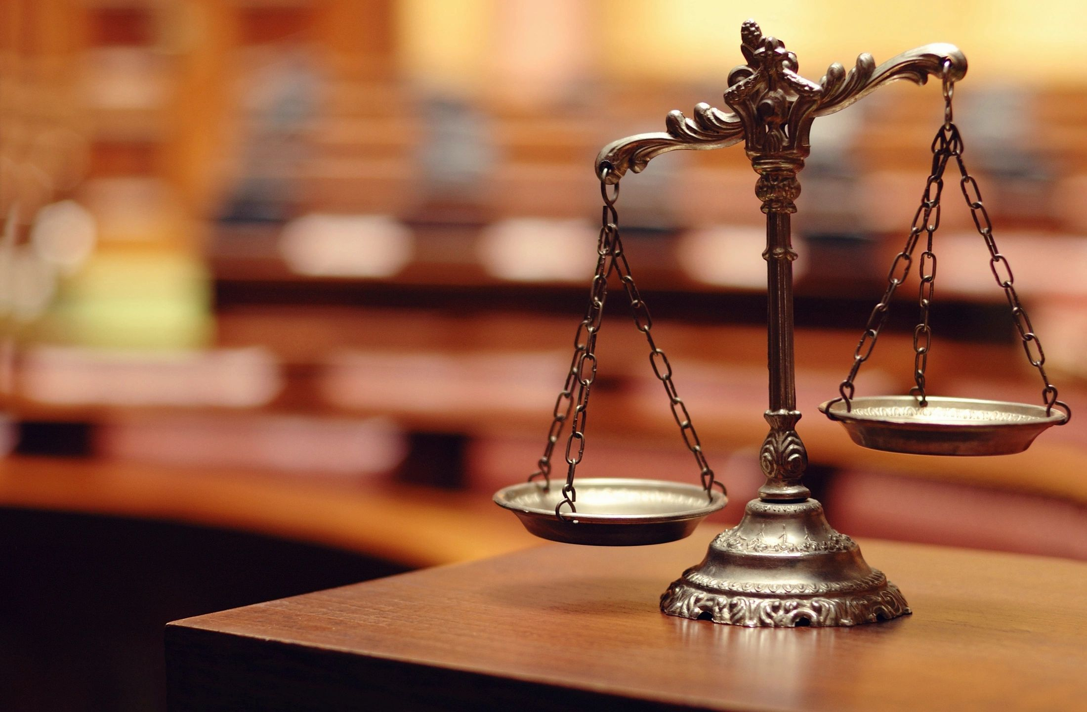 Scales of justice for legal counseling and legal services.